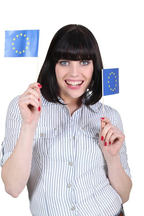 Bandiere castane dell'europeo della tenuta immagini stock libere da diritti