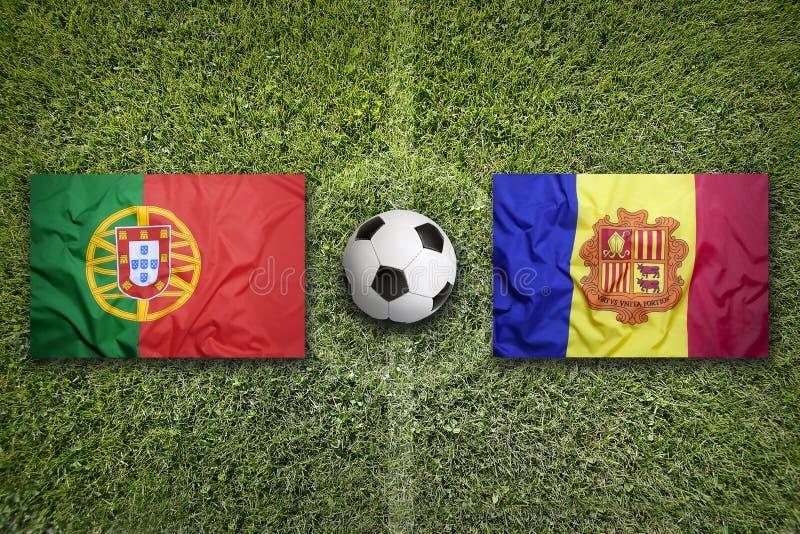 Bandiere dell'Andorra e del Portogallo sul campo di calcio fotografia stock libera da diritti