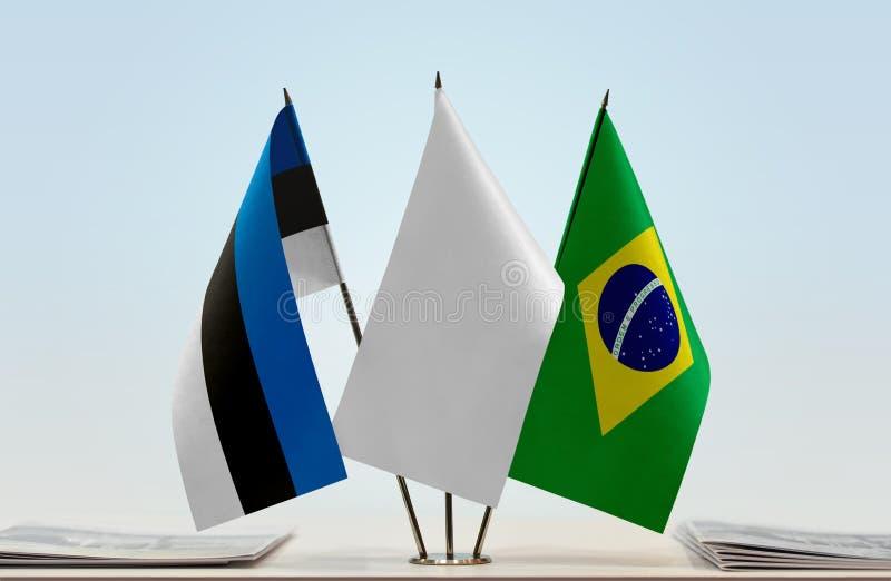 Bandiere dell'Estonia e del Brasile immagine stock libera da diritti