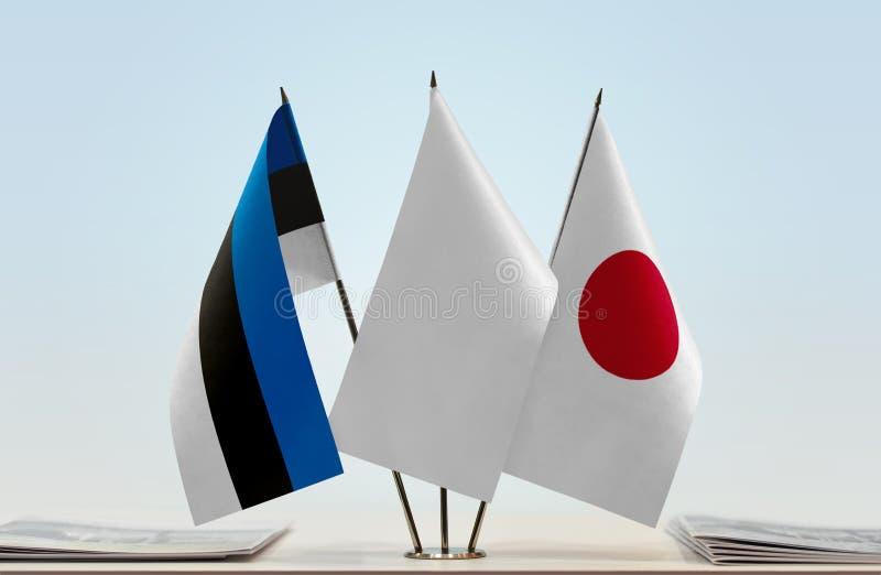 Bandiere dell'Estonia e del Giappone fotografia stock libera da diritti