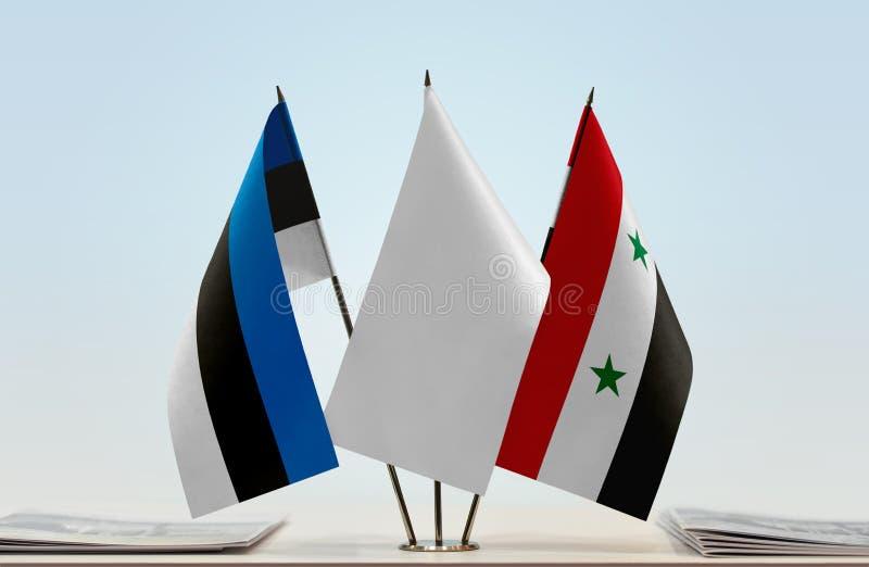Bandiere dell'Estonia e della Siria fotografie stock