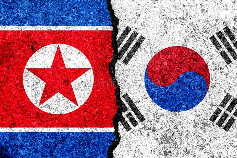 Bandiere della Corea del Sud e della Corea del Nord dipinte sul BAC incrinato della parete illustrazione vettoriale