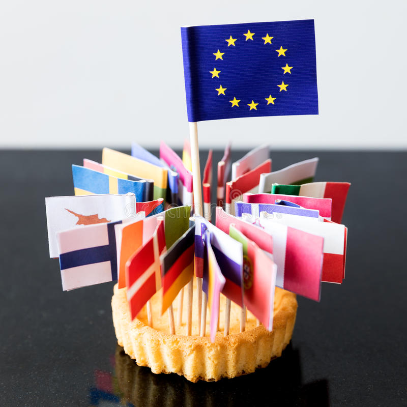 Bandiere di Unione Europea in un dolce fotografia stock