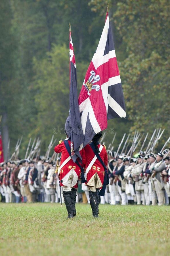Bandierina britannica e truppe britanniche fotografie stock