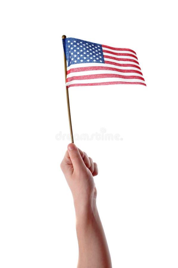 Bandierina degli S.U.A. della holding della mano fotografie stock