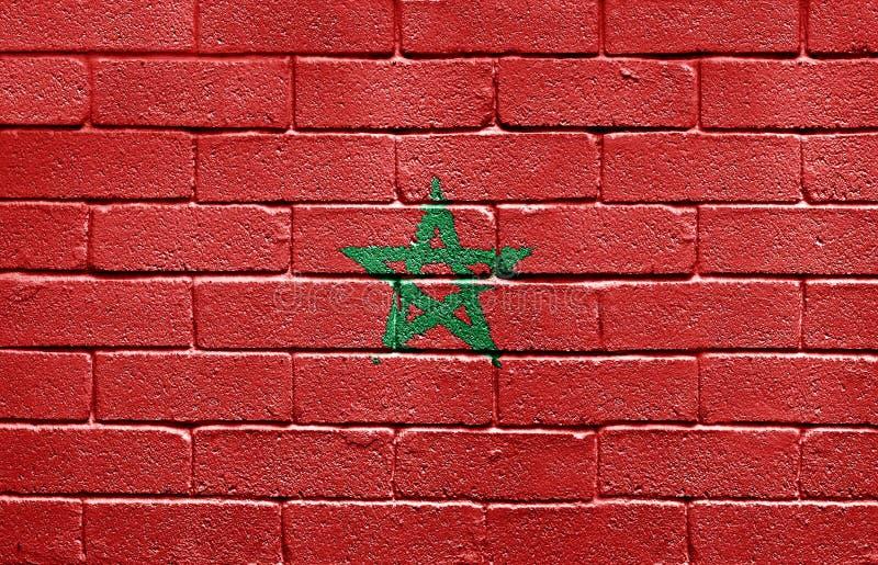 Bandierina del Marocco sul muro di mattoni immagine stock