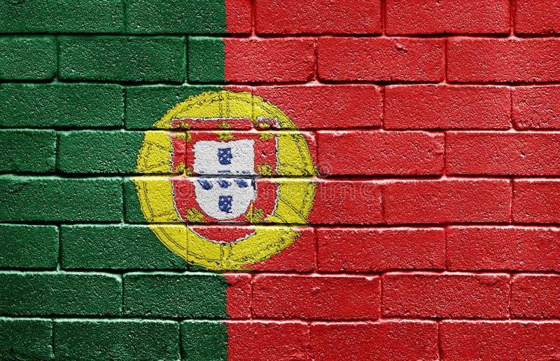 Bandierina del Portogallo sul muro di mattoni immagine stock libera da diritti