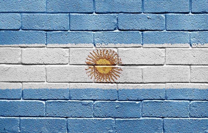 Bandierina dell'Argentina sul muro di mattoni immagine stock