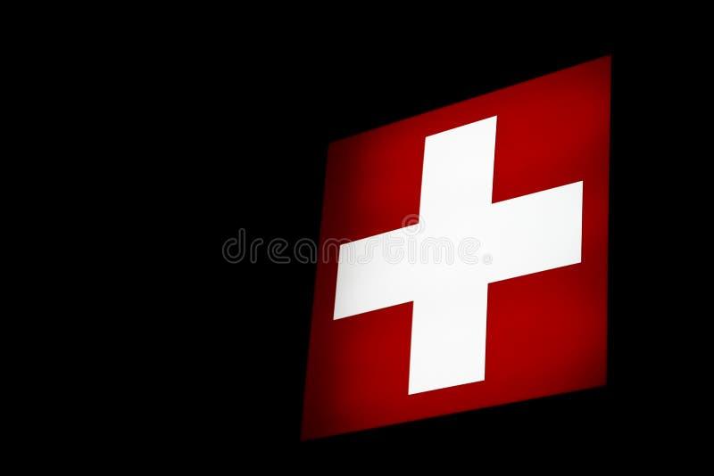 Bandierina svizzera di lucent fotografia stock libera da diritti