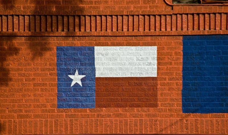 Bandierina verniciata del Texas sul muro di mattoni fotografie stock libere da diritti