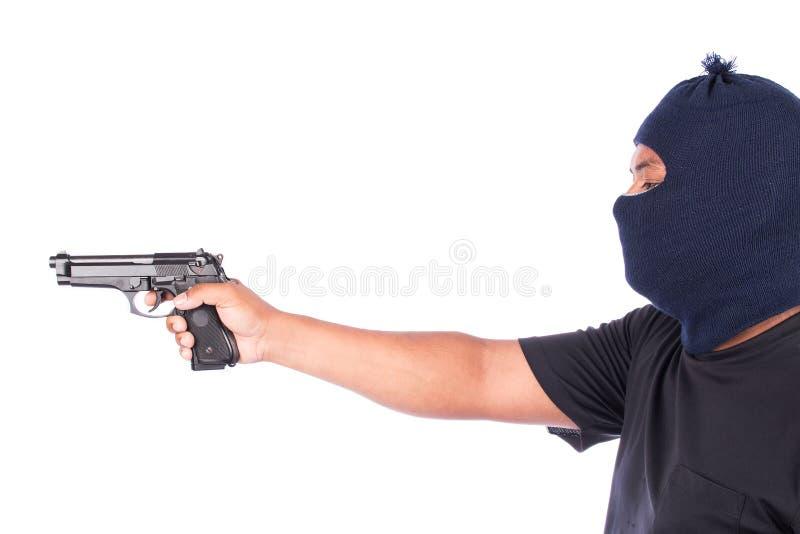 Bandiet met in hand kanon stock foto's