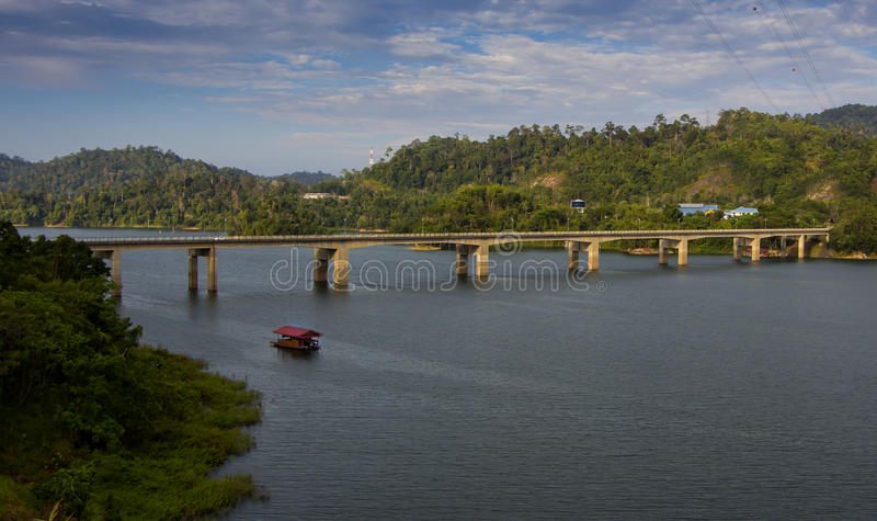 Banding Island Bridge over Temenggor Lake. In the state of Perak, Malaysia. Wooden house boat used to view spectacular tropical scenery of the lake and the royalty free stock images