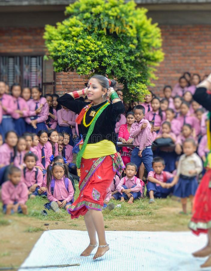 Young Nepal Dancers Practicing For School Children. Bandipur, Nepal - September 2, 2016 Young Nepal Dancers Practicing For Tej Festival In Front of Elementary stock image