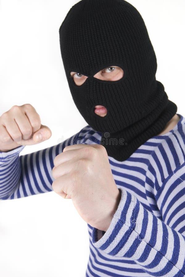 Bandit. Wearing black military mask royalty free stock image