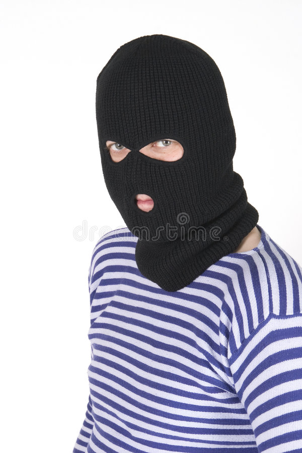 Bandit. Wearing black military mask stock photography