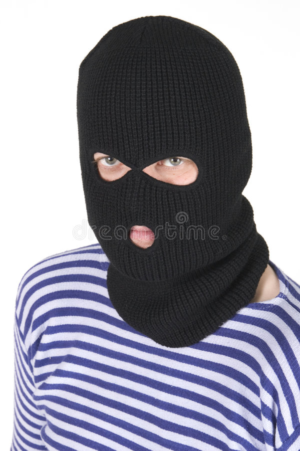 Bandit. Wearing black military mask stock images