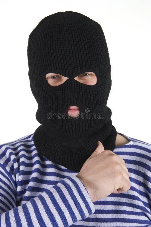 Bandit. Wearing black military mask royalty free stock photos