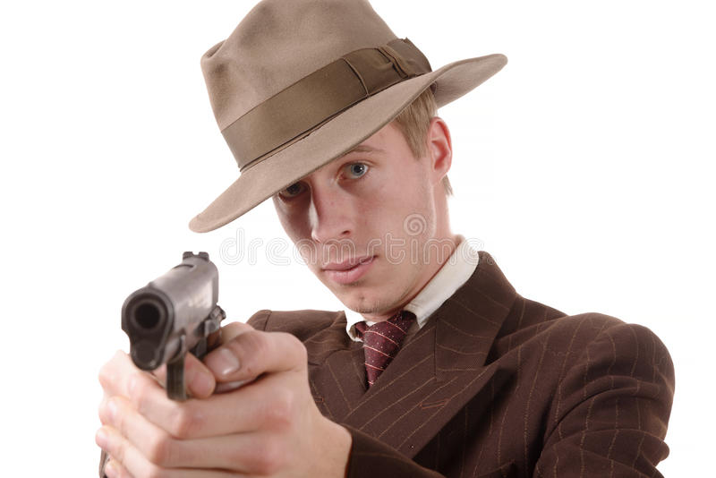 Bandit dans un vintage de costume, but avec une arme à feu photographie stock