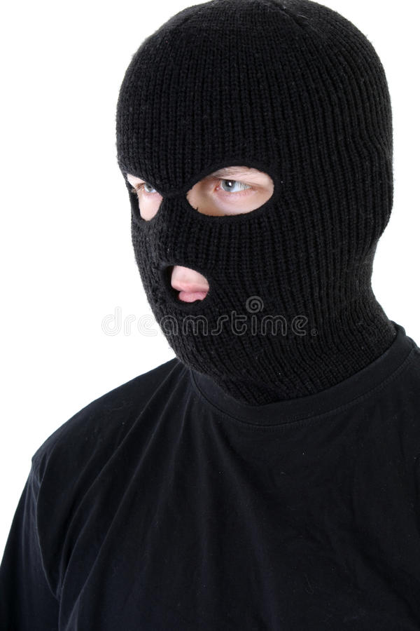 Bandit in mask. Angry gangster in black mask stock photos