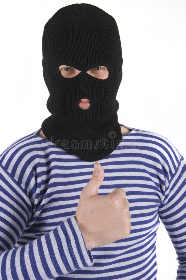 Bandit, thumbs up. Bandit wearing military mask, thumbs up royalty free stock images