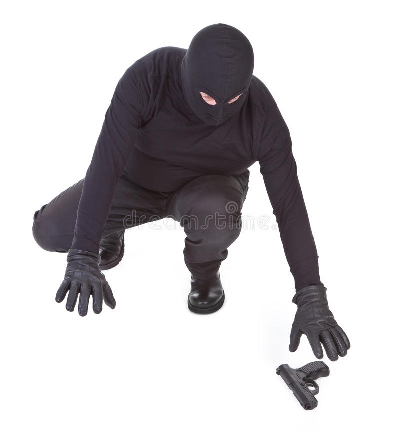 Download Bandit Is Trying To Recover His Weapon Stock Photo - Image: 19345836