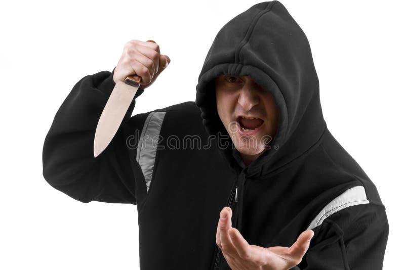 Bandito nel nero con la lama fotografia stock