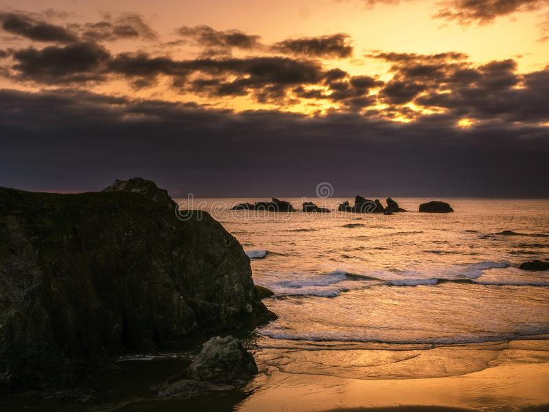 Bandon strandsolnedgång arkivbild