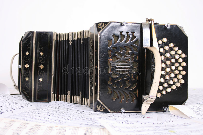 Bandoneon with music sheets royalty free stock photo