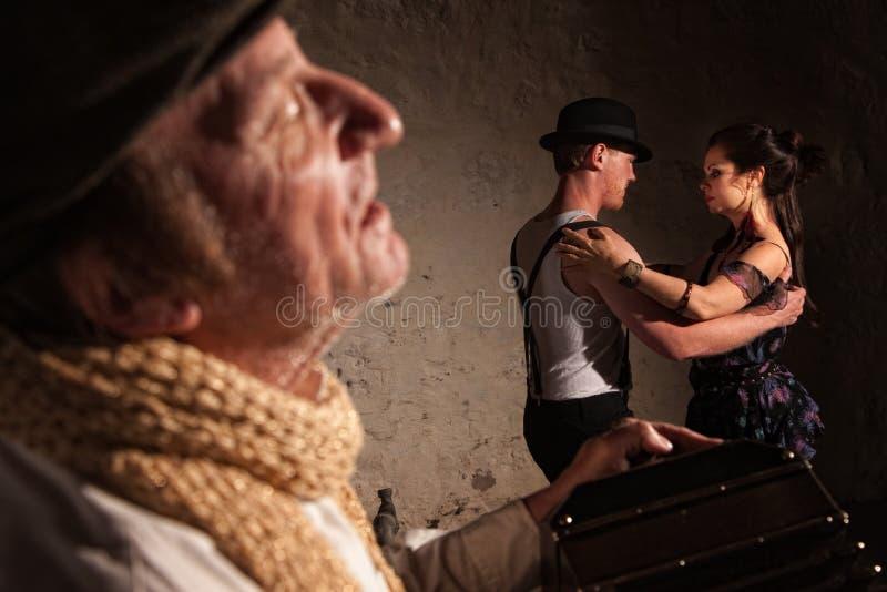 Bandoneon Player with Tango Dancers stock image