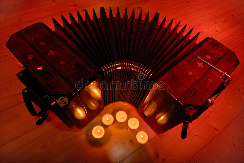 Bandoneon and tea candles royalty free stock photography
