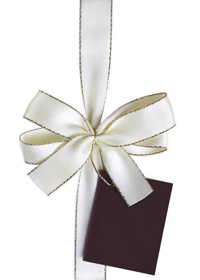 Bandpilbåge med gåvaetiketten royaltyfri foto