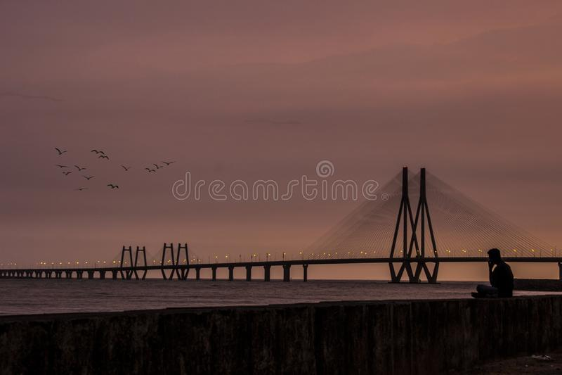 Bandra worli sea link during sunset with amazing shades. Soothing colour of sunset at Mumbai. Room for text. Copy space royalty free stock photography