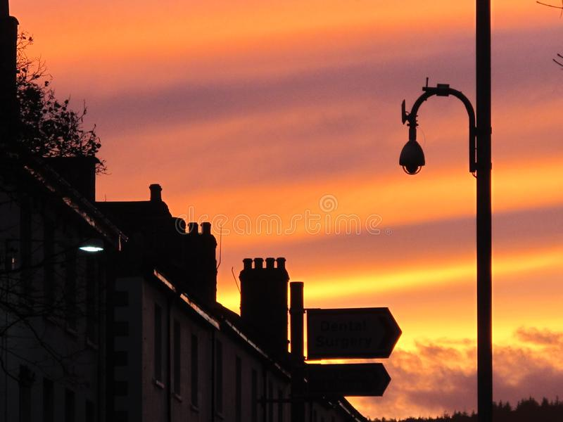 Beautiful evening sunset over a row of terrace houses in England. Bands of colored sky during a sunset over a row of terrace houses in England stock images