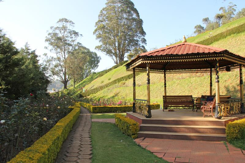 The bandstand in the Rose Garden. The Government Rose Garden is situated on the slopes of the Elk Hill in Vijayanagaram of Ooty town in Tamil Nadu, India at an royalty free stock image