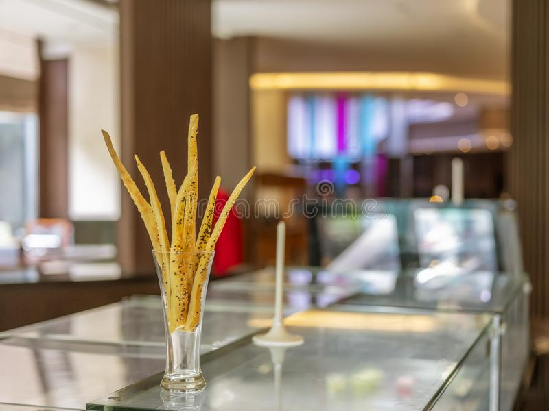 A home-made cheese stick decorated in the glass located in Bandung, Indonesia. BANDUNG, INDONESIA – NOVEMBER 19, 2018 : A home-made cheese stick decorated stock images