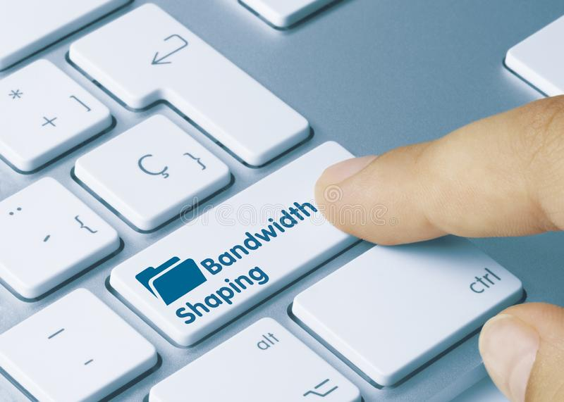Bandwidth Shaping - Inscription on White Keyboard Key. Bandwidth Shaping Written on White Key of Metallic Keyboard. Finger pressing key stock photography