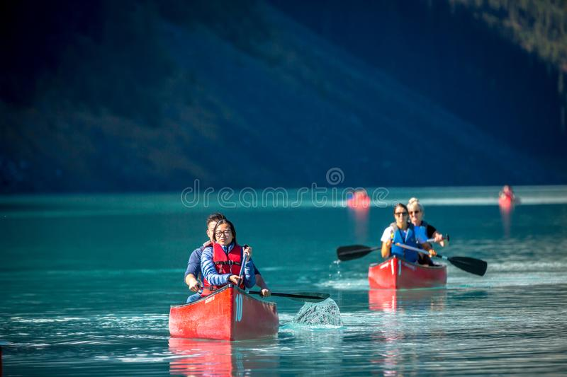 Banff, Canada - Ago 17th 2017 - Locals and tourists doing kayak in a amazing green lake Moraine in the early hours of a summer day stock image