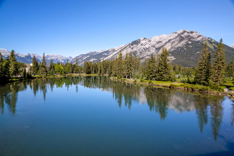 Banff - river Bow with Rocky mountain backdrop royalty free stock photography