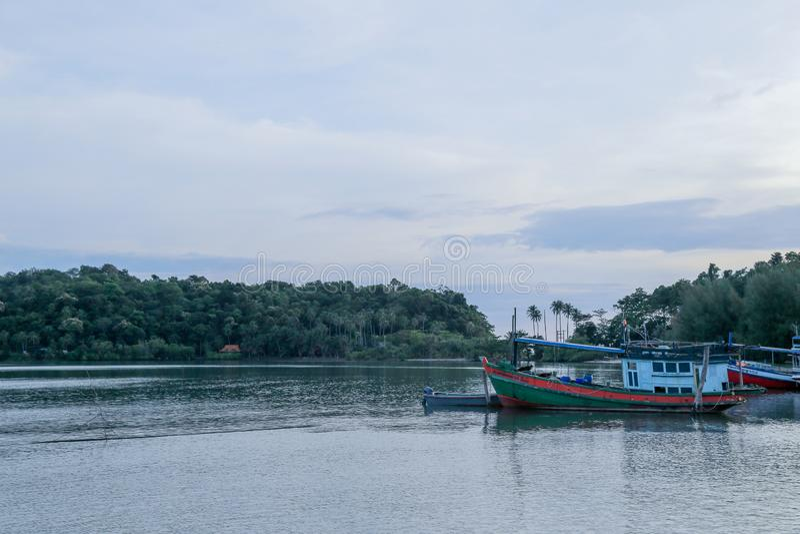 Bang Bao Village, Koh Chang Island, Trat, Thailand. October 2019 : Sencnic of Bangbao Koh Chang area with Fisherman ship and Floating house during evening royalty free stock photos