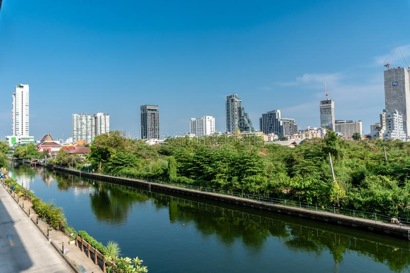 Bang Sue Canal in Bangkok, Thailand in Summer. Bang Sue Canal in Bangkok, Thailand with Office Building in Background in Summer royalty free stock images
