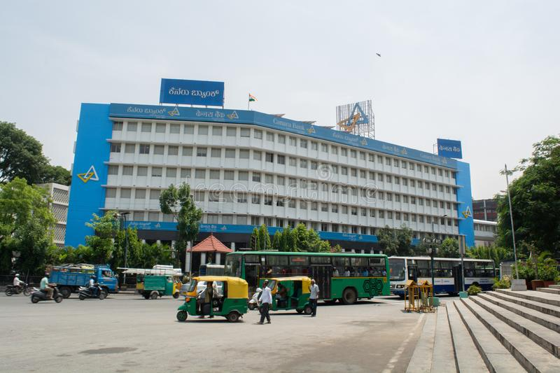 Bangalore, India, June 4, 2019 :Big Canara Bank buillding near corporation circle with heavy traffic. Bangalore, India, June 4, 2019 :Big Canara Bank buillding stock photo
