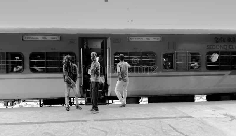 BANGALORE INDIA June 3, 2019 :Black and white Image of People outside the train waiting for the train movement.  stock photography