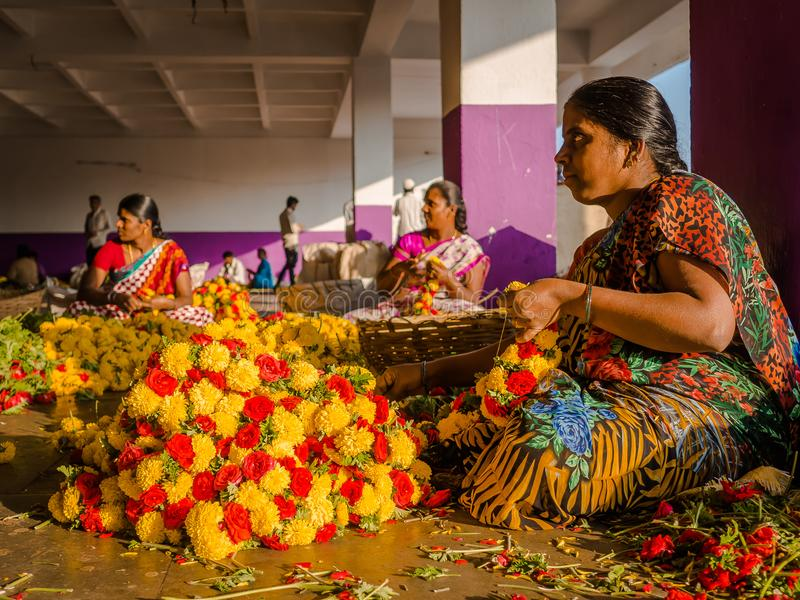 BANGALORE, INDIA - June 06 2017: Flower sellers at KR Market in Bangalore. in Bangalore, India stock photos