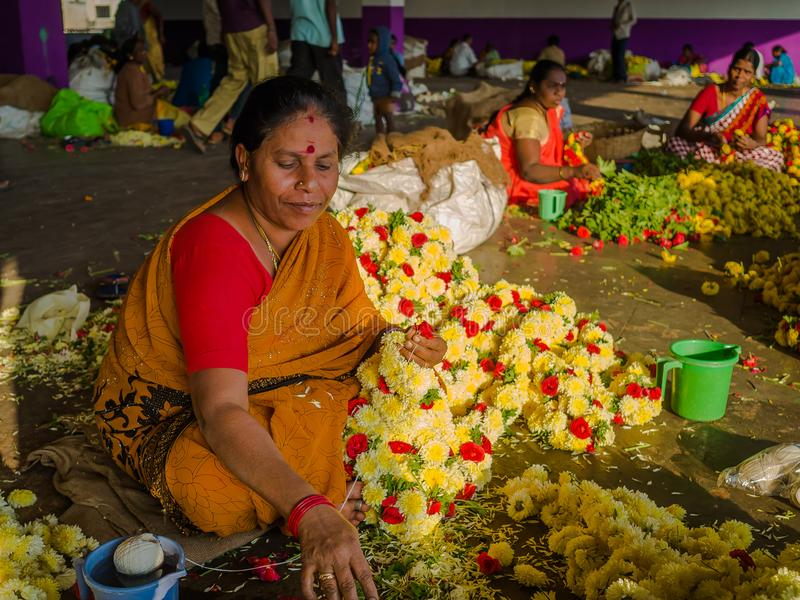 BANGALORE, INDIA - June 06 2017: Flower sellers at KR Market in Bangalore. in Bangalore, India stock image