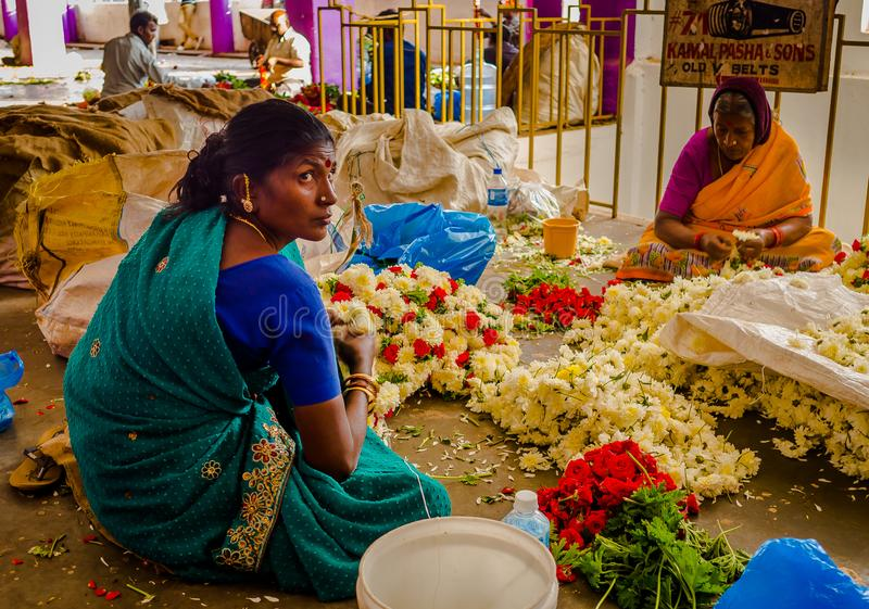 BANGALORE, INDIA - June 06 2017: Flower sellers at KR Market in Bangalore. in Bangalore, India royalty free stock image