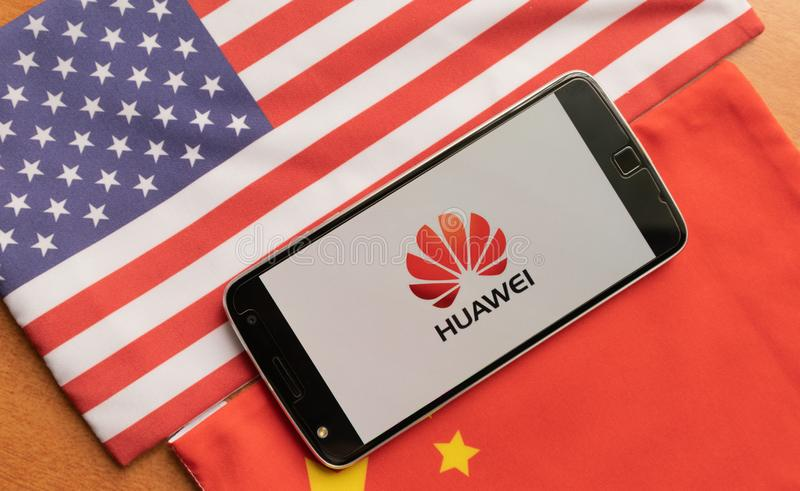 Bangalore, India, June 4, 2019 : Huawei Logo in Mobile, kept on the US and china flag stock image