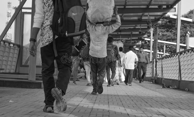 BANGALORE INDIA June 2, 2019 :Low view ange of a People walking at Bengalore Bus station, Karnataka. BANGALORE INDIA June 2, 2019 :Low view angle of a People royalty free stock image