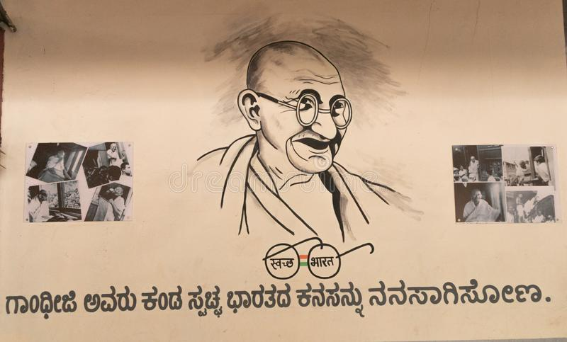 Bangalore India - June 3, 2019: Painting of Mahatma Gandhi at Indian railway station with images of Indian freedom struggle and. Swachh bharath campaign symbol royalty free stock photography