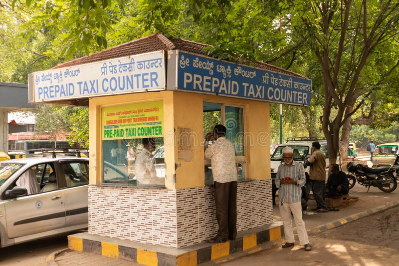 BANGALORE INDIA June 3, 2019 : Prepaid taxi counter at Bengaluru railway station. Karnataka, India royalty free stock photos