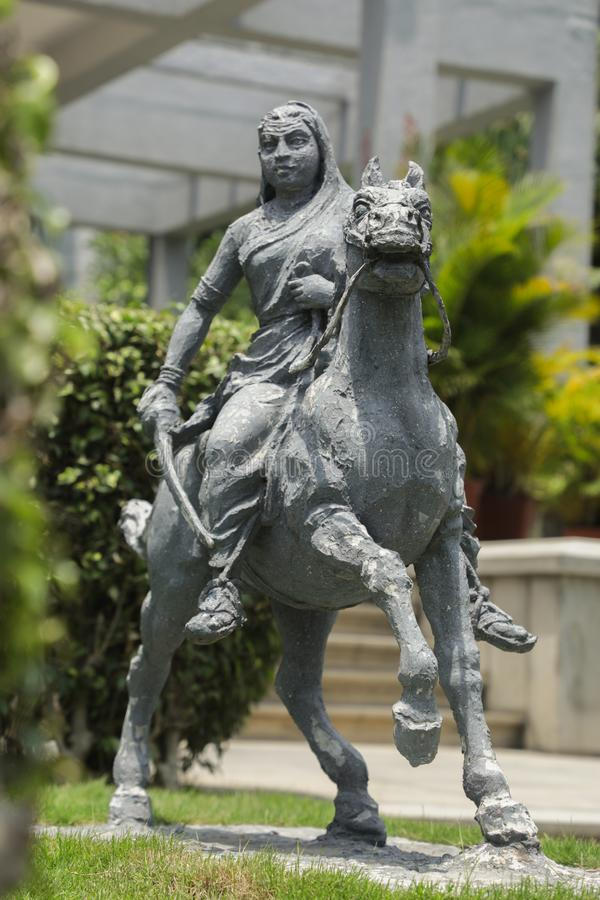 Bangalore, India, June 4, 2019 : Sculpture of queen Kittur Rani Chennamma on horse at Bengaluru, Karnataka, India royalty free stock image